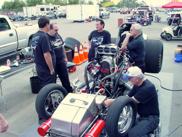 Paolo, Vince, Porter, Smokey and Tim McCutcheon prepping the race car